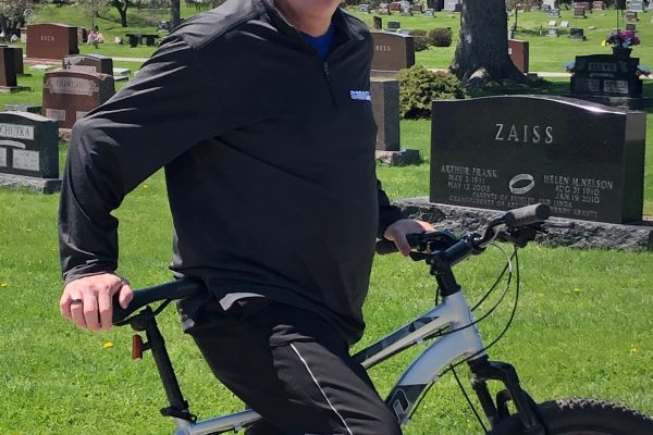 Charles Jon Garst standing with a bike